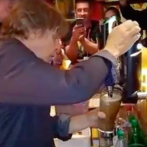 Mark Hamill pulling a pint in the Moorings, Portmagee